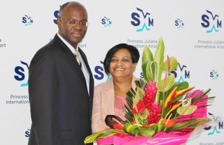 Dec 2013 - Governor Eugene Holiday poses with his successor at SXM Airport, managing director Regina LaBega after presenting her with a bouquet of flowers on occasion of the airport's 70th anniversary celebrations. (SXM Airport photo)